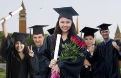 Graduado con las rosas Fotos de archivo libres de regalías