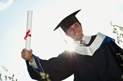 Graduado con un diploma Imagen de archivo libre de regalías