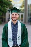 Graduado da faculdade no terreno em Oregon Foto de Stock