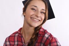 Graduado de la chica joven con el casquillo Fotos de archivo libres de regalías