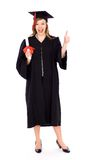 Graduado de la hembra con el pulgar para arriba Imagen de archivo libre de regalías