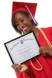Graduado de la mujer Foto de archivo libre de regalías