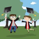 Graduado del muchacho y de la muchacha Fotografía de archivo