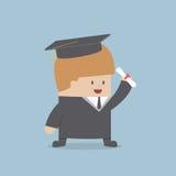 Graduado do homem de negócios no vestido e no tampão da graduação Imagens de Stock Royalty Free