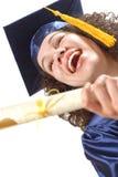 Graduado emocionado y de risa Fotos de archivo