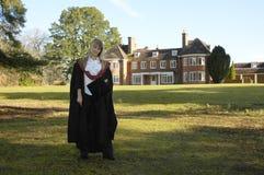 Graduado en casquillo y vestido Imágenes de archivo libres de regalías