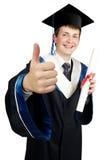 Graduado feliz del muchacho Imagenes de archivo