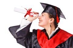 Graduado feliz joven que mira de mirada al futuro Imágenes de archivo libres de regalías