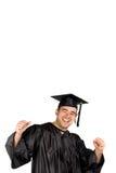 Graduado feliz que celebra Foto de archivo libre de regalías