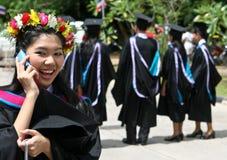 Graduado no telefone Foto de Stock