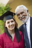 Graduado novo da fêmea com avô fotografia de stock