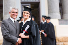 Graduado y padre Imagenes de archivo