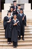 Graduados de universidad del grupo fotografía de archivo