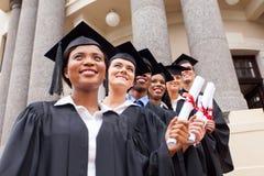 Graduados de universidad del grupo fotos de archivo