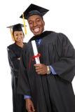 Graduados del hombre y de la mujer Foto de archivo libre de regalías