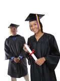 Graduados do homem e da mulher Fotos de Stock Royalty Free
