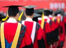 Graduados durante o começo Imagens de Stock