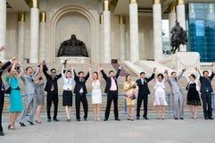 Graduados felices de la universidad Imágenes de archivo libres de regalías