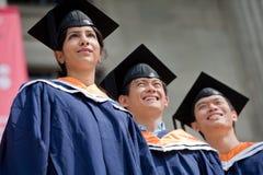 Graduados jovenes Imagen de archivo libre de regalías