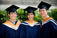 Graduados jovenes Imagenes de archivo