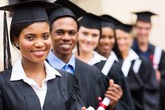 Graduados multiculturales de la universidad Imagen de archivo libre de regalías