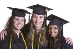 Graduados sonrientes Imagen de archivo libre de regalías
