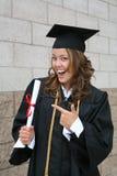 Graduate. A pretty graduate celebrating her success with diploma Stock Photos