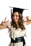Graduate. A smiling graduate girl on white background Royalty Free Stock Photo