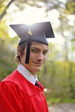 Student in cap and gown. Outside for graduation stock photos
