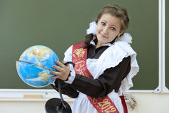 The graduate. Of school holds the spoilt globe Stock Image
