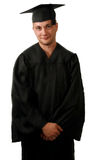Graduate. A man in a graduation cap and gown Royalty Free Stock Photo