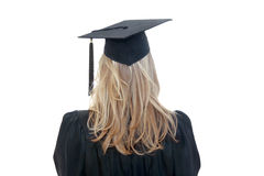 Graduate. Back view of a blonde graduate student in cap and gown isolated on white Royalty Free Stock Photo