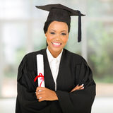 Graduate with arms crossed Royalty Free Stock Images