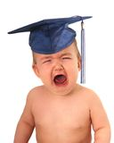 Graduate baby. Crying baby wearing grad cap. High cost of education concept Stock Photo