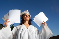 Graduate blank papers. Young graduate woman with blank papers Stock Photo