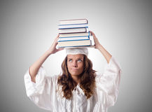 Graduate with book against the gradient Royalty Free Stock Photos