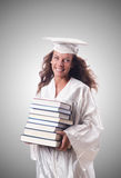 Graduate with book against the gradient Stock Photo