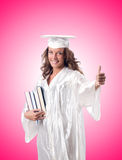 Graduate with book against the gradient Royalty Free Stock Images