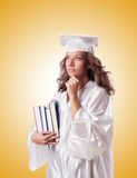 Graduate with book isolated on the white Stock Image