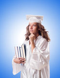 Graduate with book isolated on the white Royalty Free Stock Photo