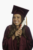 Graduate in cap and gown Stock Photo