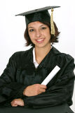 Graduate in cap and gown. Holding diploma as she graduate's on white background Stock Photography