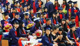 Graduate ceremony at university. HO CHI MINH CITY, VIETNAM- AUG 8 : Group of student in gown uniform sitting, wait for graduate ceremony at university, young Royalty Free Stock Images