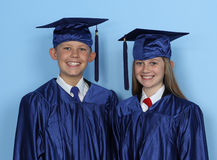 Graduate children Royalty Free Stock Photos