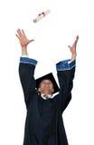 Graduate in cloak throwing diploma Stock Images