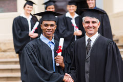 Graduate with dean. Portrait of handsome african american male graduate with dean Royalty Free Stock Photo