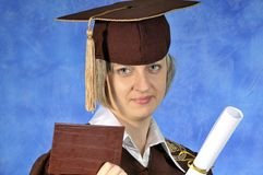Graduate with diploma Stock Images