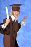 Graduate with diploma Stock Image