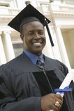 Graduate with Diploma outside university portrait Royalty Free Stock Photos