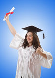 Graduate with diploma on white Stock Image
